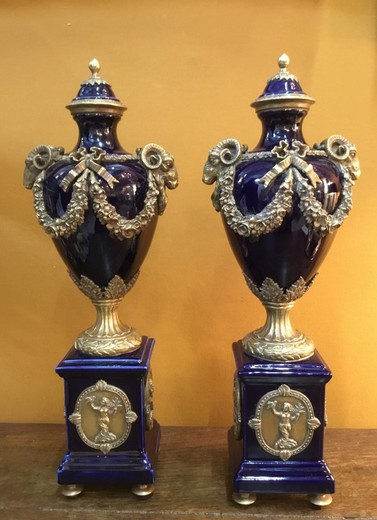 Antique paired vases with covers