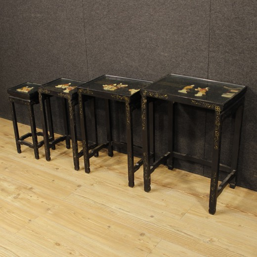 Set of French side tables from the 20th century. Beautiful furniture in lacquered and painted wood with soap stone decorations. Set consisting of four tables with glass tops, of a fair size and service.Side tables ideal to be inserted in a living room but
