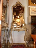 Antique console with a mirror
