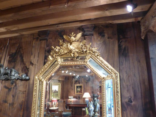 Antique mirror in the style of Henry II / The frame is made of wood with gilding. France, XIX century.