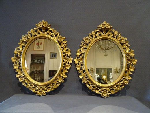 Antique paired mirrors