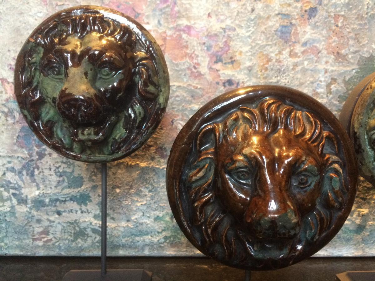 Antique terracotta lions heads