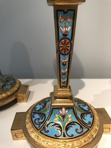 A pair of antique candlesticks
