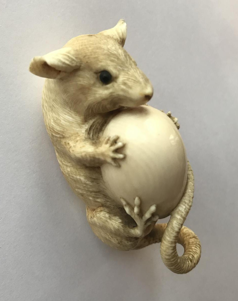 japanese okimono of a mouse with an egg