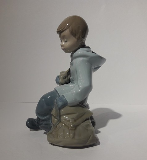 Antique sculpture of a boy with a rabbit
