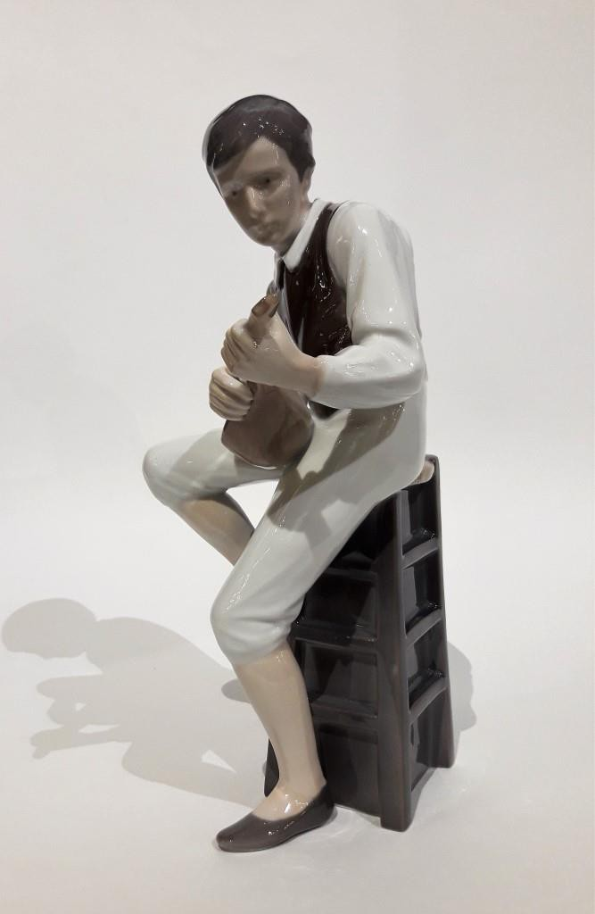 "Antique sculpture ""Boy with a Mandolin"""
