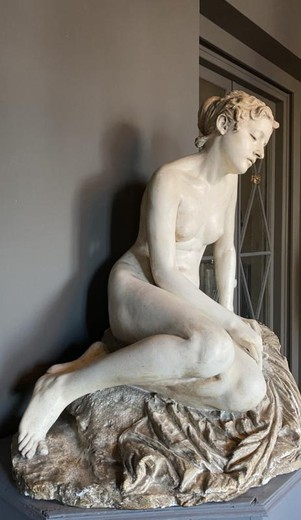 antique sculpture of a naked girl