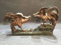Antique sculpture of roosters' fight