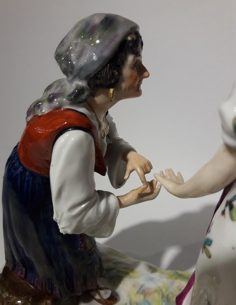 Antique sculpture of a lady and a fortune teller