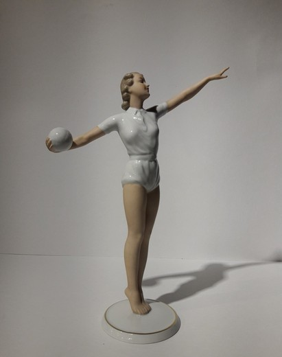 Antique sculpture of a volley ball player