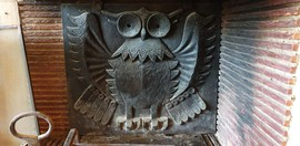 antique fireplace plate made as an owl