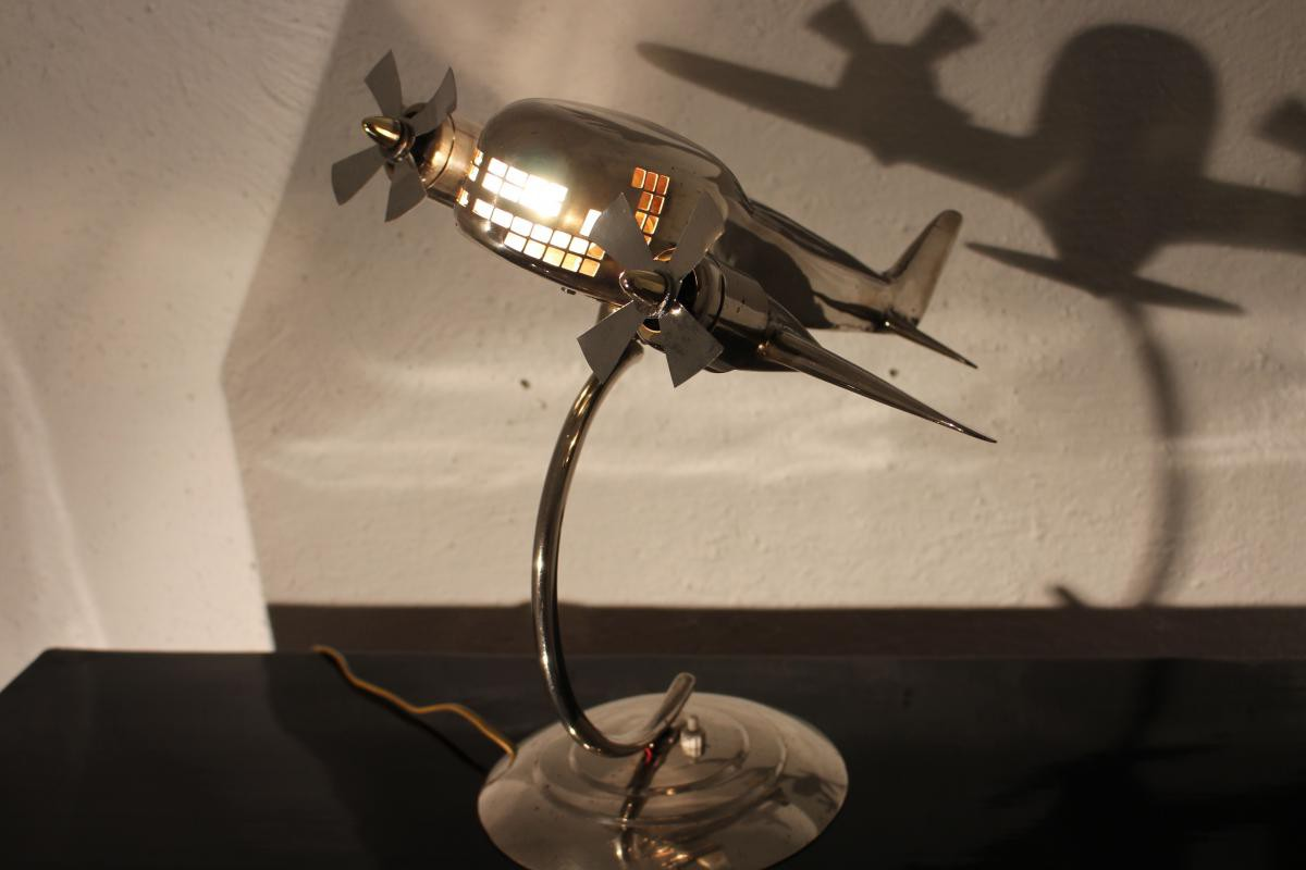 Antique airplane mounted as a lamp