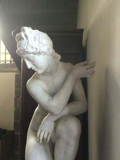 Antique sculpture Venus after bathing