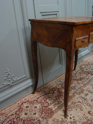 Antique dressing table in the style of Louis XV. Made of wood in marquetry. France, XIX century.