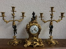 Antique clock and pair of candelabra