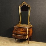 Antique chest of drawers with a mirror