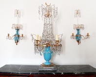 Antique girandole and paired sconces