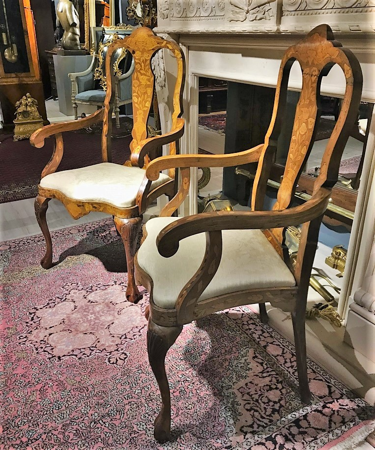 A pair of antique chairs