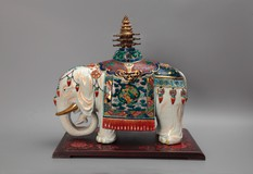 Sculpture of an elephant with a pagoda on the back