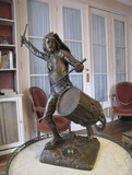Antique bronze sculpture of a young guy with the drum