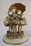 "Antique sculpture ""Three girls under an umbrella"""