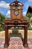 Antique fireplace portal with a clock