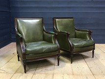 Paired leather armchairs in the style of Louis XVI
