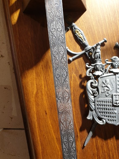 Vintage wall panel with swords
