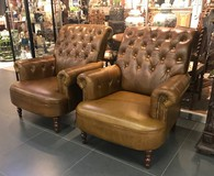 Leather twin armchairs