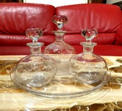 Set of three decanters on a tray
