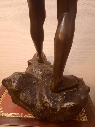 "Antique sculpture ""A young man on a stone"""