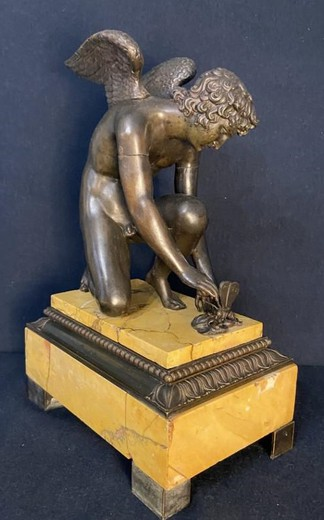 "Antique sculpture ""Cupid playing with a butterfly"""