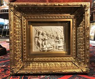 Antique bas-relief in a frame