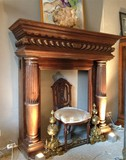 antique wooden fireplace with carved columns
