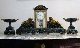 Antique clock set in bronze and marble